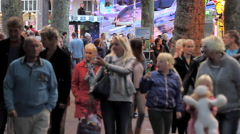 People visiting the annual traveling carnival in Hoorn Stock Footage