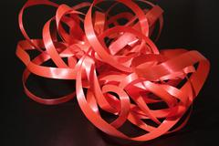 Red gift-wrap ribbon, close-up - stock photo