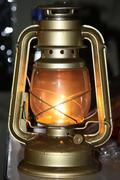a glowing hurricane lamp - stock photo