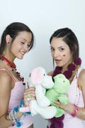 Two young female friends with stuffed animals, portrait - stock photo