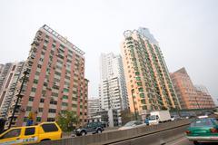 China, Guangdong Province, Guangzhou, street and high rises Stock Photos
