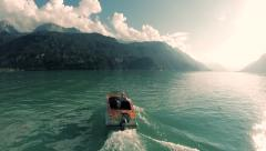 Carefree man riding motorboat on lake at sunset. happiness freedom lifestyle Stock Footage