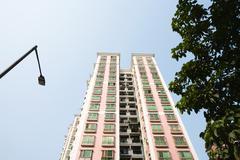 China, Guangdong Province, Guangzhou, high rise, low angle view - stock photo