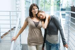 Mother with teenage daughter resting head on her shoulder Stock Photos