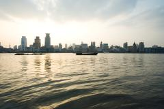 China, Guangdong Province, Guangzhou, view of high rises from river Stock Photos
