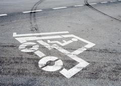 Forklift pictogram on asphalt Stock Photos