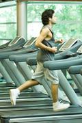 Man running on treadmill Stock Photos