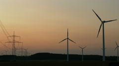 Wind energy farm at sunset - stock footage