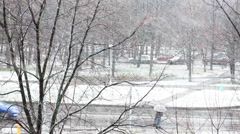 The girl runs across the road at the first winter snow - stock footage