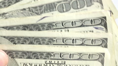 Hand moving through 100 dollar bills slowly Stock Footage