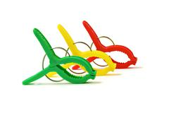Colorful plastic clothes pegs on white background Stock Photos