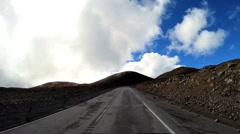 POV driving rough mountain road Mt Mauna Kea Big Island Hawaii USA Stock Footage