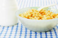 star shaped cereal and milk - stock photo