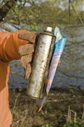 Holding rusty spray bottle - stock photo