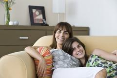 Mother and teenage daughter spending time together - stock photo