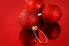 Christmas card with red baubles and sparkles Stock Photos
