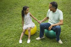 Father and daughter together in park - stock photo