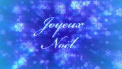 Joyeux Noel: Merry Christmas in French, on background of blue snowflakes. Stock Footage