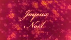 Joyeux Noel: Merry Christmas in French, on background of red snowflakes. Stock Footage