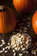roasted salty pumpkin seeds - stock photo
