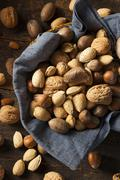 assortment of whole raw mixed nuts - stock photo