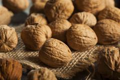 raw organic whole walnuts - stock photo
