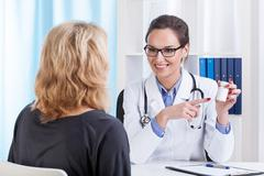 Doctor recommending medicines Stock Photos