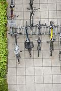 Stock Photo of Bicycles parked in bicycle rack, overhead view