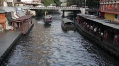 ASIA TRANSPORTATION (BOATS) - High angle canal, with boat passing under Stock Footage