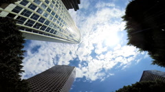 Skyscrapers apartments blue sky clouds Urban living Los Angeles California - stock footage