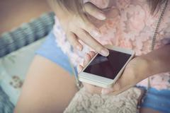 women using a smart phone, hand touch on screen digital mobile, shallow depth - stock photo