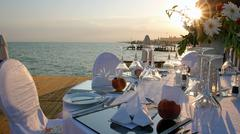 Romantic Table Setting on Pier at Sunset Stock Photos