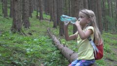 Little Girl Face Drinking Water, Happy Child Relaxing in Forest, Mountains Trail Stock Footage