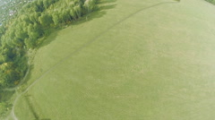 Aerial view. Flying over the green field. Stock Footage