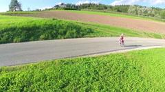 Little boy running on empty road in slow motion Stock Footage