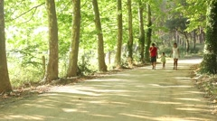 Happy family walking outdoors Stock Footage