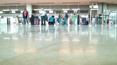 Time lapse of airline passengers in an airport - stock footage