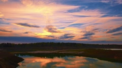 Dramatic sunset over forest lake, landscape, time-lapse Stock Footage