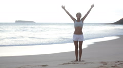 Free woman enjoying freedom feeling happy at beach Stock Footage