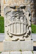coat of arms belonging to the walls of avila - stock photo
