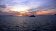 Stock Video Footage of Cruise Ferry Ship Sailing at the Colorful Sunset. Slow Motion.