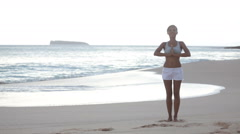 Meditation Yoga woman meditating at beach on Hawaii Stock Footage