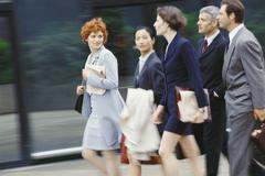 Group of business executives walking, blurred motion - stock photo