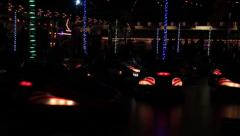 Bumper cars on a carnival at night Stock Footage