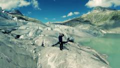 Male hiker standing on glacier enjoying mountain nature landscape Stock Footage