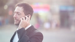 Man talking on Iphone [lens flare] - stock footage