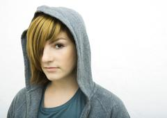 Young woman wearing hood, looking at camera, portrait Stock Photos