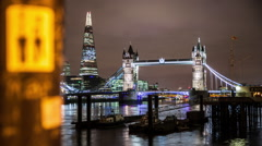 Stunning night time lapse of Tower Bridge and The Shard in London Stock Footage