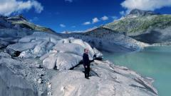 Aerial view of man standing on glacier ice landscape. adventure background Stock Footage
