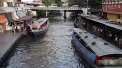 ASIA TRANSPORTATION (BOATS) - WS view two boats arrive & passengers exit left Stock Footage